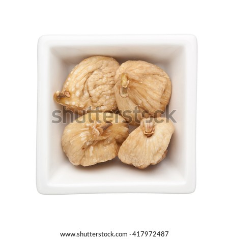 Dried figs in a square bowl isolated on white background - stock photo