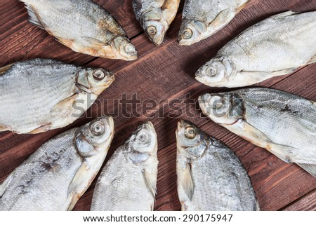 Dried fish on a wooden background, traditional russian snack for a beer. - stock photo