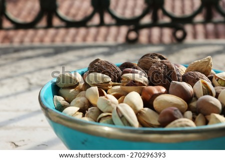Dried fruit in a turquoise bowl  background - stock photo