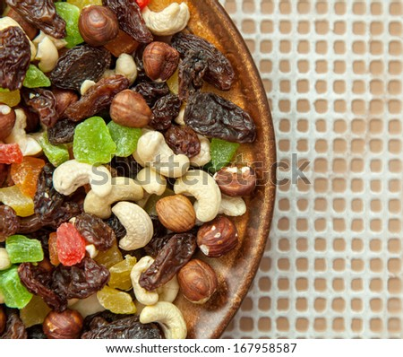 dried fruits and nuts on brown plate - stock photo
