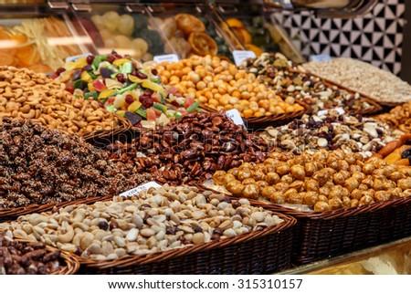 dried fruits at Mercat de Sant Josep de La boqueria Market in Barcelona - stock photo