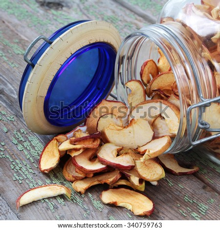 Dried fruits in a glass jar on a table - stock photo