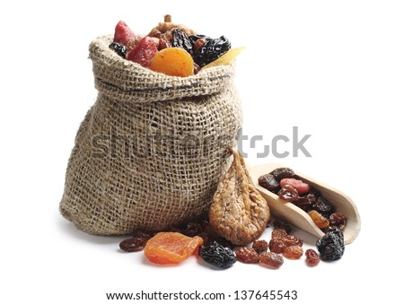 Dried fruits in a sack and near on white background - stock photo