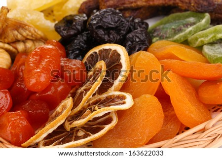 Dried fruits on wicker plate close-up - stock photo