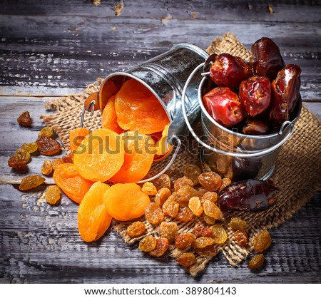 Dried fruits raisins, apricot, dates. Selective focus, toned - stock photo