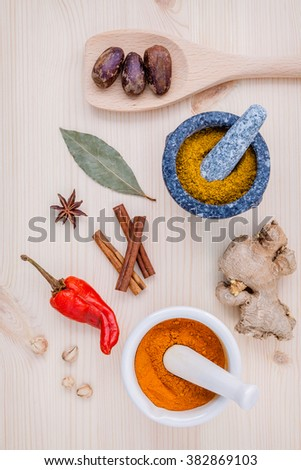 Dried herbs and spices nutmeg,star anise ,cinnamon stick ,ginger ,bay leave and chili on wooden table. Top view with copy space. - stock photo