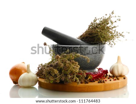 dried herbs in mortar and vegetables, isolatrd on white - stock photo