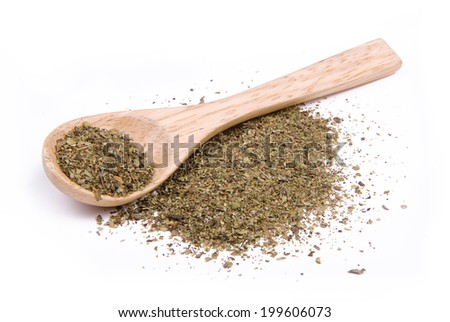 Dried herbs spices in a wooden spoon - stock photo