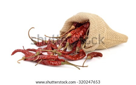 dried hot red chillies in a sack on white backgroud - stock photo