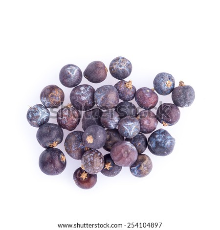 Dried juniper berries isolated on a white background - stock photo