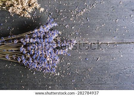 dried lavender bunches on dark wooden table - stock photo