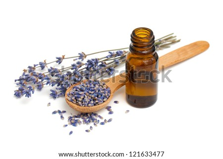 Dried lavender with a bottle of essential oil over white - stock photo