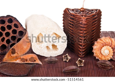 dried lotus loofah seashell and candle standing on mat - stock photo