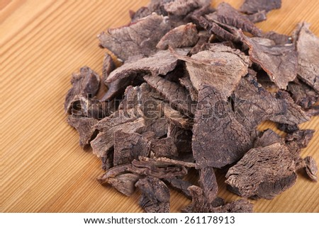 Dried meat cut into thin slices closeup - stock photo