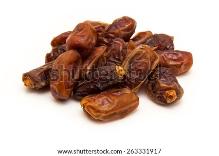 Dried Medjool dates isolated on a white background. Medjool  - stock photo