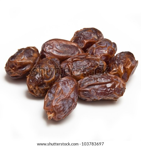 Dried Medjool dates isolated on a white studio background. - stock photo