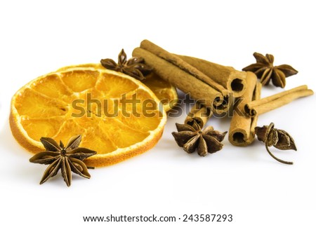 dried orange rings with some anise stars and cinnamon sticks - stock photo