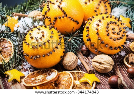 dried oranges and oranges with cloves. Christmas decorations. focus on orange - stock photo