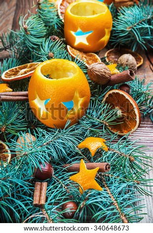 dried oranges with nuts and fir branches on the floor. Christmas decorations. - stock photo