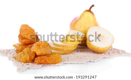 Dried pears on color napkin, isolated on white - stock photo