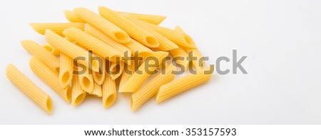 Dried penne regate pasta or cylinder shaped pasta over white background - stock photo