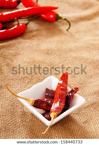 Dried pepper on a fabric system. - stock photo