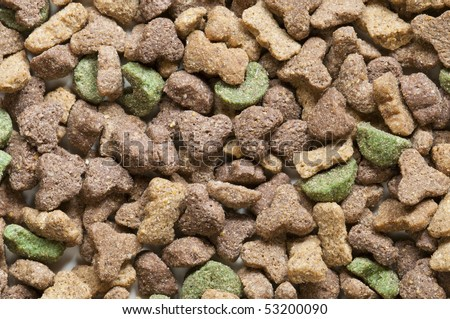 Dried pet food of many colors - stock photo