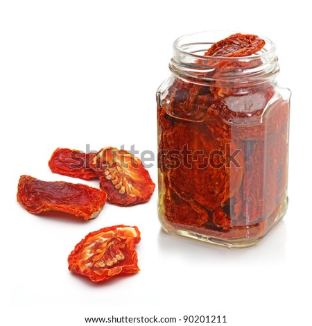 Dried plum tomatoes on white background - stock photo