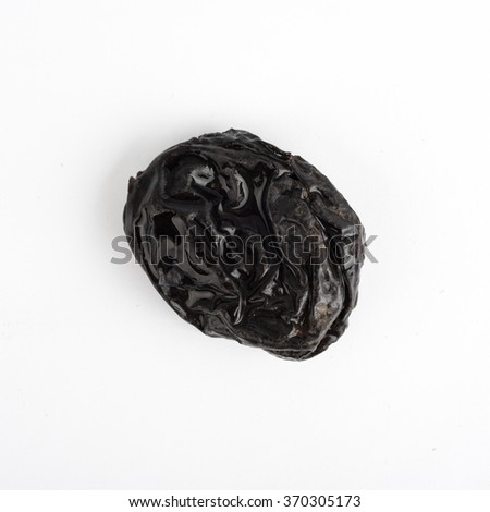 Dried plums prunes on white background - stock photo