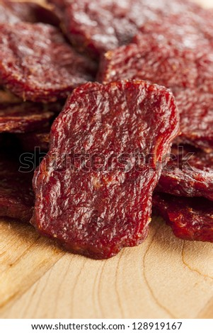 Dried Processed Beef Jerky against a background - stock photo