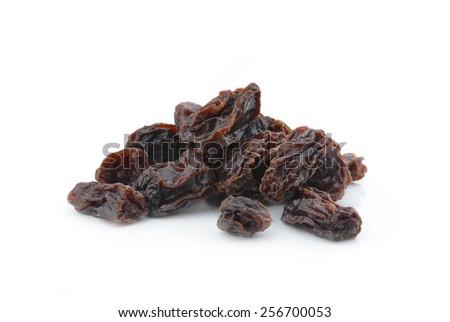 Dried raisins on a white background - stock photo