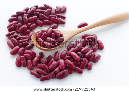 Dried Red Beans with wooden Spoon on white background - stock photo