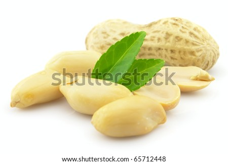 Dried roasted peanuts on a white background - stock photo