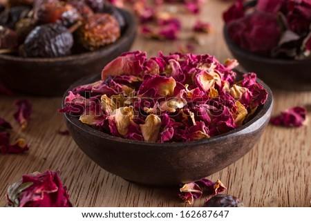 Dried rose petals: for tea, alternative medicine, pot-pourri. Copy space. - stock photo