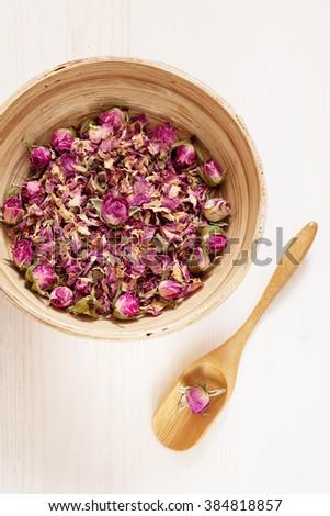 Dried rose petals: for tea, alternative medicine, selective focus - stock photo