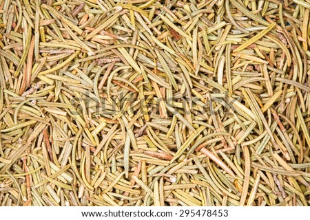 Dried rosemary as background texture. - stock photo