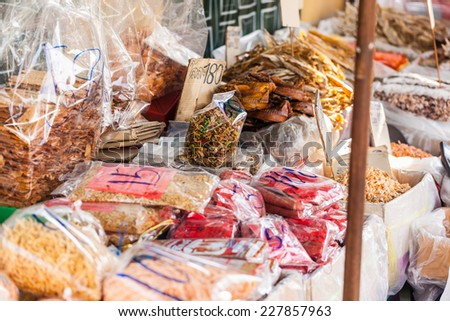 dried seafood on sale in a thai street market in Bangkok, Thailand - stock photo