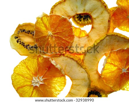 Dried slices of apple and orange and kiwi - stock photo