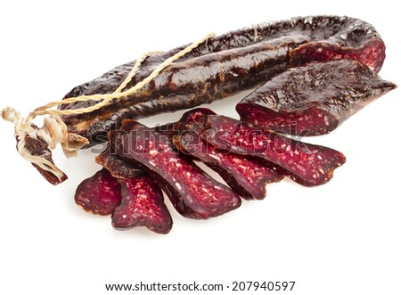 dried solid sausages sudzhuk isolated on white background - stock photo