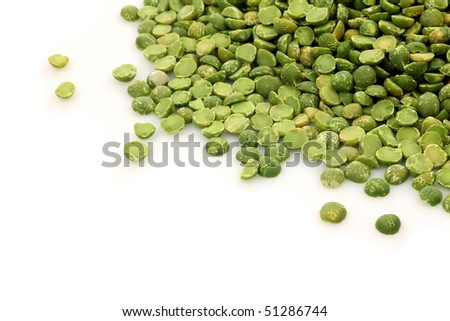 dried split peas on a white background - stock photo