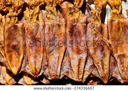 Dried squid on asian fish market for background - stock photo