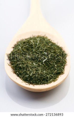 Dried thyme on wooden spoon - stock photo