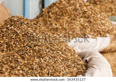Dried tobacco leaves at the indian market - stock photo