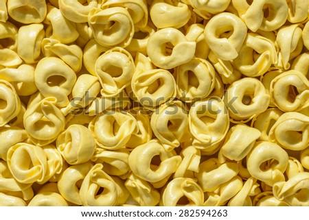 Dried tortellini background - stock photo