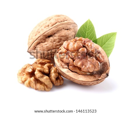 Dried walnuts with leaves - stock photo