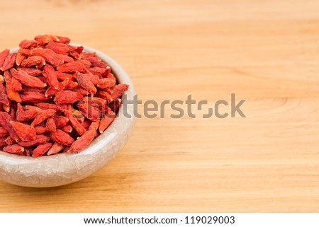 dried wolfberry fruit in bowl on the table - stock photo