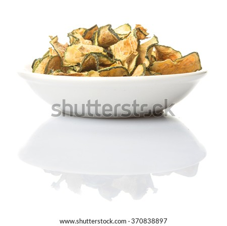 Dried zucchini or courgette in white bowl over white background - stock photo