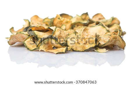 Dried zucchini or courgette over white background - stock photo