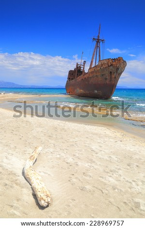 Drift wood and ship wreck on Selinitsa beach, Gytheio, Greece - stock photo