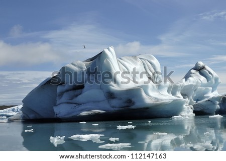 Drifting iceberg in Jokulsarlon ice lagoon. - stock photo